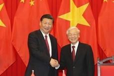 越共中央总书记阮富仲与中共中央总书记、国家主席习近平举行会谈