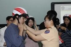 胡志明市加大关于处理违反交通规则的外国人的宣传力度