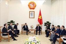 阮春福会见美国国际发展金融公司首席执行官亚当• 伯勒尔