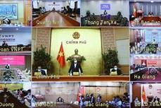 越南政府总理阮春福:迅速为人民开展新冠疫苗接种
