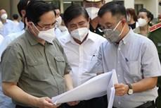 范明政总理:从现在到月底将有至少200万剂新冠疫苗到达胡志明市