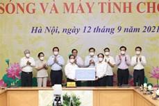 """政府总理范明政启动""""给儿童的网络和电脑""""项目"""