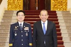 越南政府副总理张和平会见韩国警察厅司令金昌勇一行