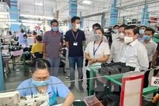胡志明市坚持与受疫情影响企业共同度过难关
