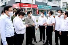 越南政府总理范明政赴胡志明市视察疫情防控工作