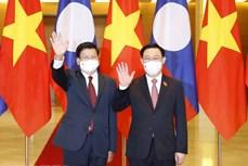 越南国会主席王廷惠会见老挝人民革命党总书记、国家主席通伦