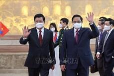 越南政府总理范明政会见老挝人民革命党总书记、国家主席通伦
