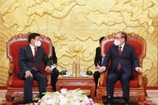 老挝人民革命党总书记、国家主席通伦会见前越共中央总书记农德孟和前国家主席陈德良