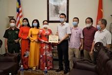 越南驻马来西亚大使馆接收新冠肺炎疫苗基金援助资金