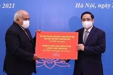 越南政府总理范明政会见古巴驻越大使 向古方捐赠大米