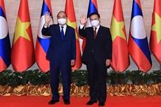 老挝媒体密集报道越南国家主席阮春福对老挝进行的正式友好访问