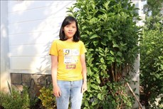 Cô gái Raglai Pi Xuân Thảo tự hào khi được mang trên mình bộ quân phục
