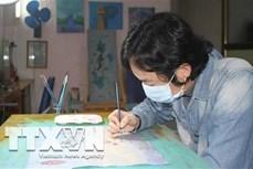 Họa sỹ trẻ Phan Tuấn Ngọc vẽ tranh tuyên truyền phòng, chống dịch COVID-19
