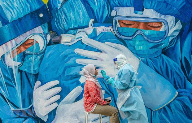 马来西亚重新实行封锁令 新加坡加快新冠病毒疫苗接种工作 hinh anh 1