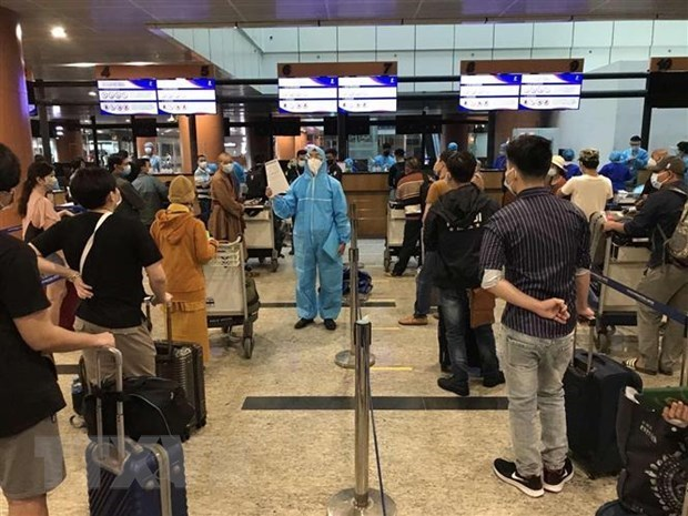 新冠肺炎疫情:将在缅甸的逾390名越南公民接回国 hinh anh 1