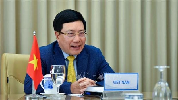 越南政府副总理兼外长范平明与委内瑞拉外长豪尔赫·阿雷亚萨举行视频会谈 hinh anh 1