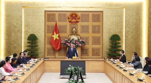 政府总理阮春福:政府一直与企业并肩同行 hinh anh 1