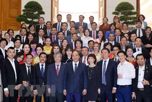 政府总理阮春福:政府一直与企业并肩同行 hinh anh 2