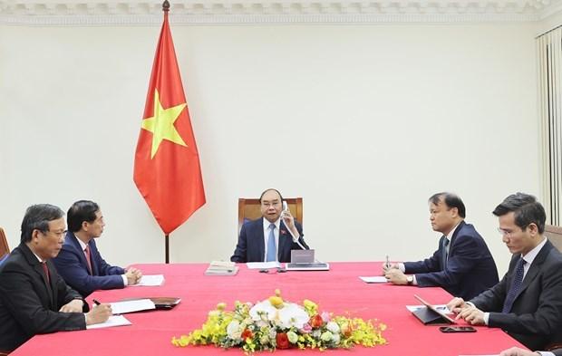 越南和智利继续在各国际组织和多边论坛上相互支持 hinh anh 1