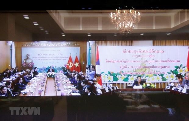 越南共产党与老挝人民革命党视频会议召开 hinh anh 1