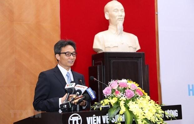 武德儋副总理:越南在确保平等获得新冠疫苗基础上使用新冠疫苗 hinh anh 1