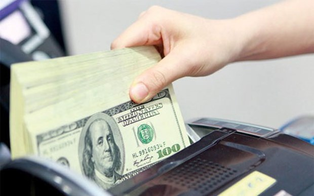 9日上午美元和人民币汇率上调7越盾 hinh anh 1