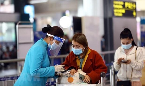 越南各家航空公司拒绝未进行健康申报的乘客登机 hinh anh 1