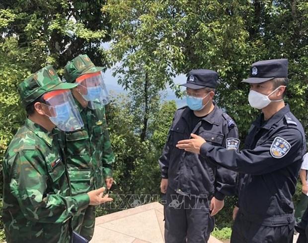 越南-中国-老挝维护边界力量举行交流会 hinh anh 1