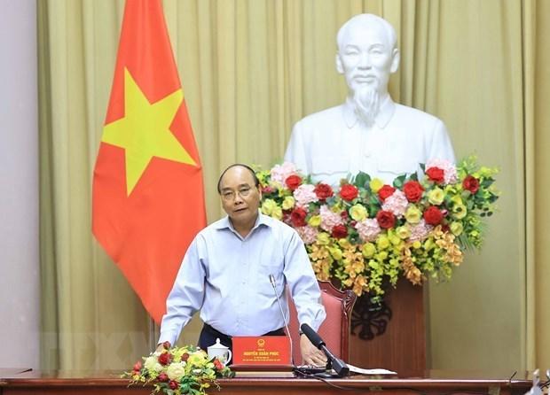 国家主席阮春福: 纺织服装业是疫情后助推经济复苏的拳头产业 hinh anh 1