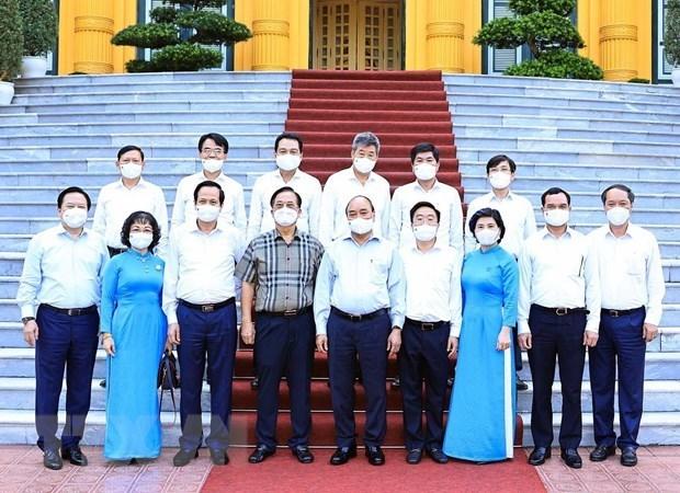 国家主席阮春福: 纺织服装业是疫情后助推经济复苏的拳头产业 hinh anh 2