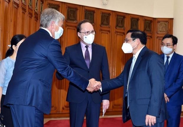 越南政府总理范明政会见俄罗斯驻越大使贝兹德科 hinh anh 1