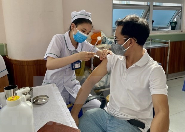 22日越南报告新增确诊病例11214例 新增治愈出院病例7580例 hinh anh 1