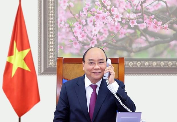 老挝总书记、政府总理通伦•西苏里和柬埔寨首相洪森与越南政府总理阮春福通电话 hinh anh 1