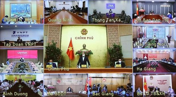越南政府总理阮春福:迅速为人民开展新冠疫苗接种 hinh anh 1