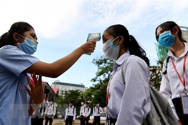 新冠肺炎疫情:柬埔寨疫情持续恶化 新加坡即将为移民工人接种疫苗 hinh anh 1