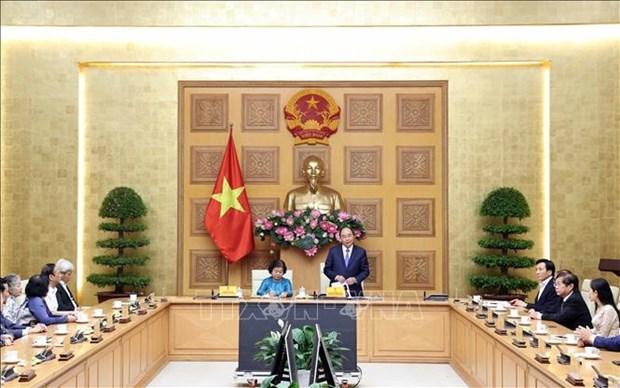 越南政府总理阮春福会见武阿丁助学基金会代表 hinh anh 1