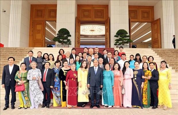 越南政府总理阮春福会见武阿丁助学基金会代表 hinh anh 2