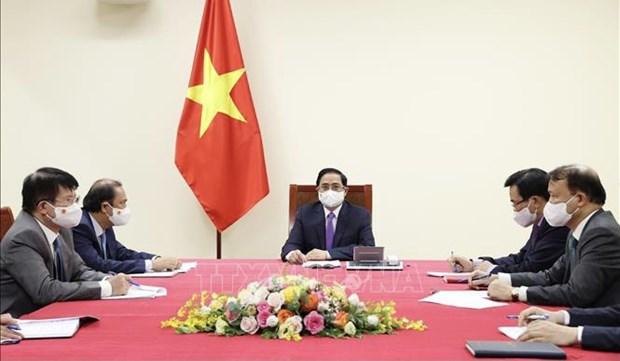 越南政府总理范明政与加拿大总理特鲁多通电话 hinh anh 1