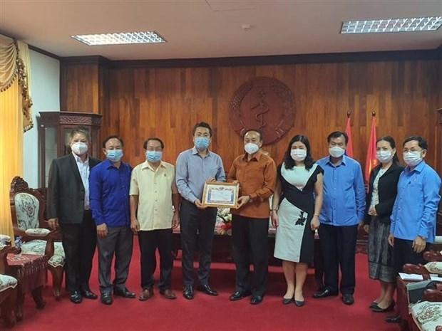 新冠肺炎疫情:在老越南人社群同老挝政府携手共同抗击疫情 hinh anh 1