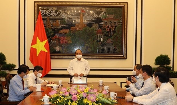 越南国家主席阮春福:共产主义杂志必须担任政治理论大旗的重要使命 hinh anh 1