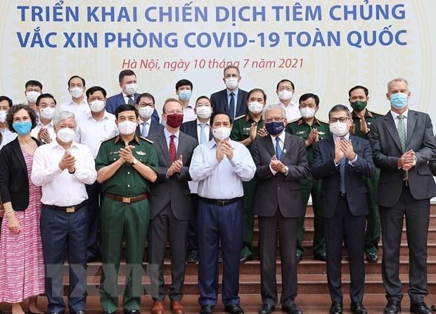 越南政府总理范明政:许多人希望优先为疫情重灾区进行新冠疫苗接种 hinh anh 2