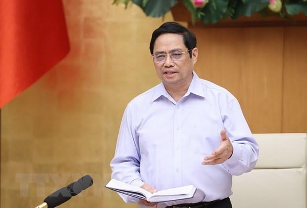 政府总理范明政:既然牺牲了经济利益 就要达到管控疫情的效果 hinh anh 1