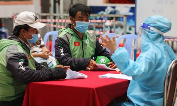 新冠肺炎疫情:胡志明市为网约配送员提供免费新冠病毒检测 hinh anh 1