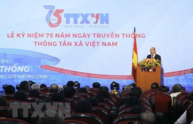政府总理阮春福:越通社继续保持党和国家可靠信息中心的地位 hinh anh 1