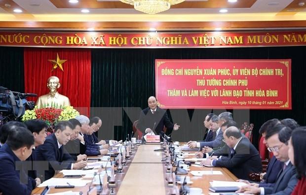 越南政府总理阮春福:和平省应更好地发挥与首都河内接壤的地理优势 hinh anh 1