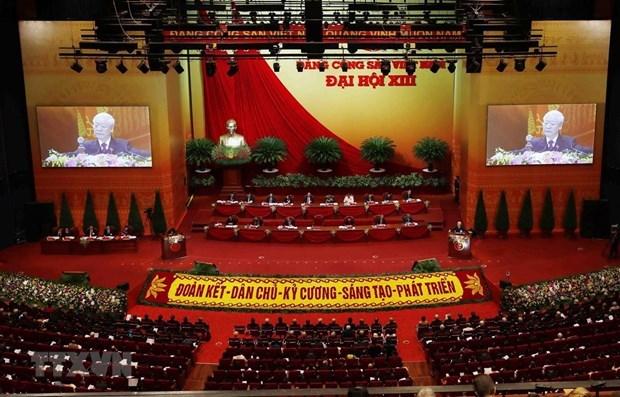 老挝媒体:越共十三大是新时期越南革命强劲发展的里程碑 hinh anh 1