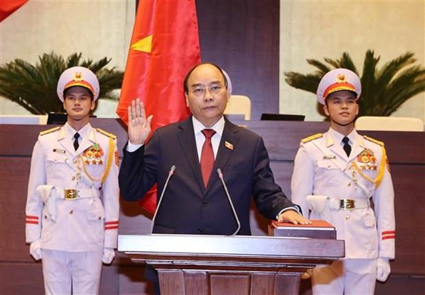 越南第十四届国会第十一次会议:阮春福以97.5%赞成票当选成为越南国家主席 hinh anh 1