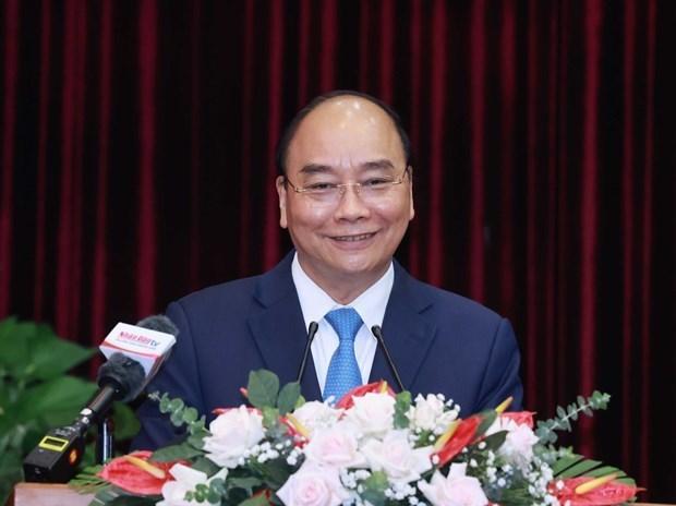 国家主席阮春福:希望广南省和岘港市成为中部地区经济增长的动力 hinh anh 1