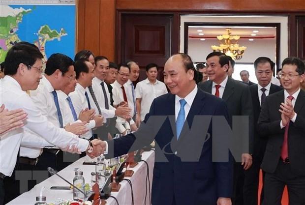 国家主席阮春福:希望广南省和岘港市成为中部地区经济增长的动力 hinh anh 2