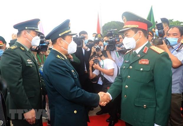越中举行第六次边境国防友好交流活动 hinh anh 1